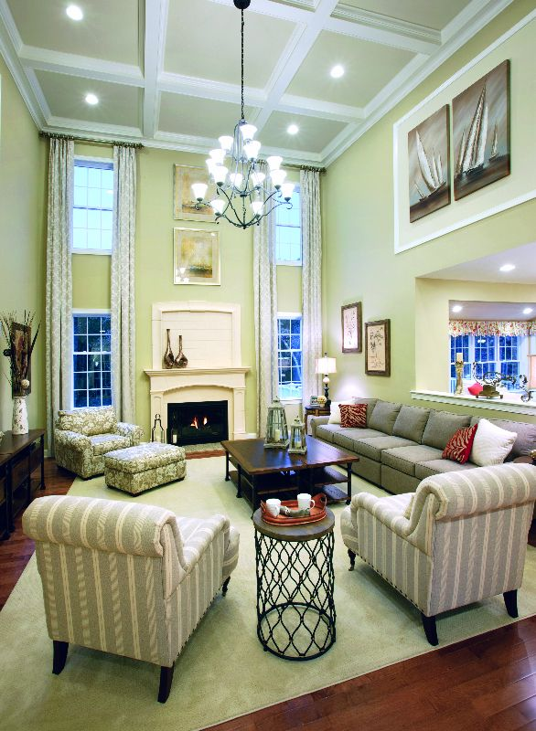 Sit back and watch a movie or cozy up by the fire in this - High ceiling wall decor ...