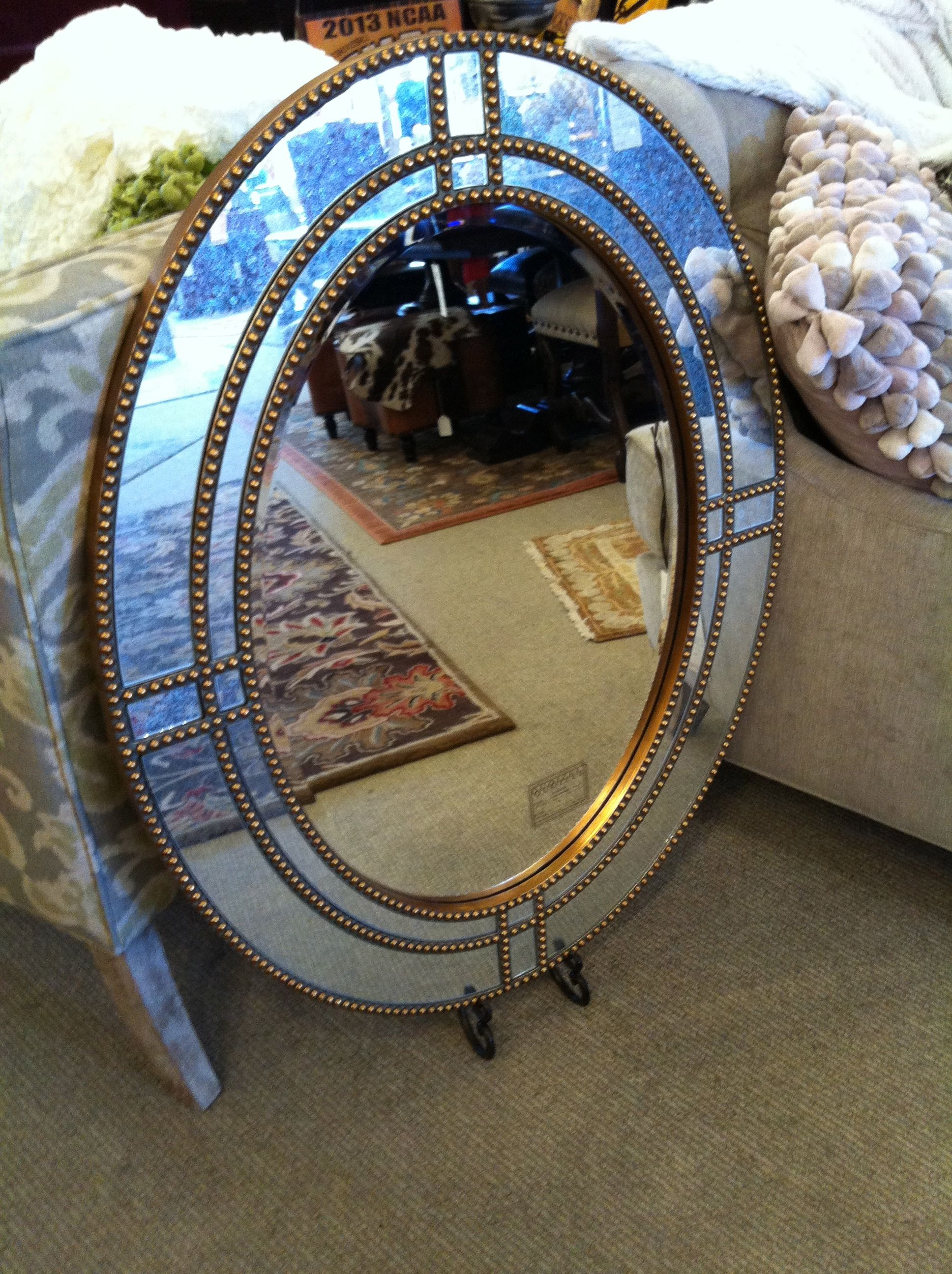 Love the different sections of this mirror and the beaded detail on the frame.