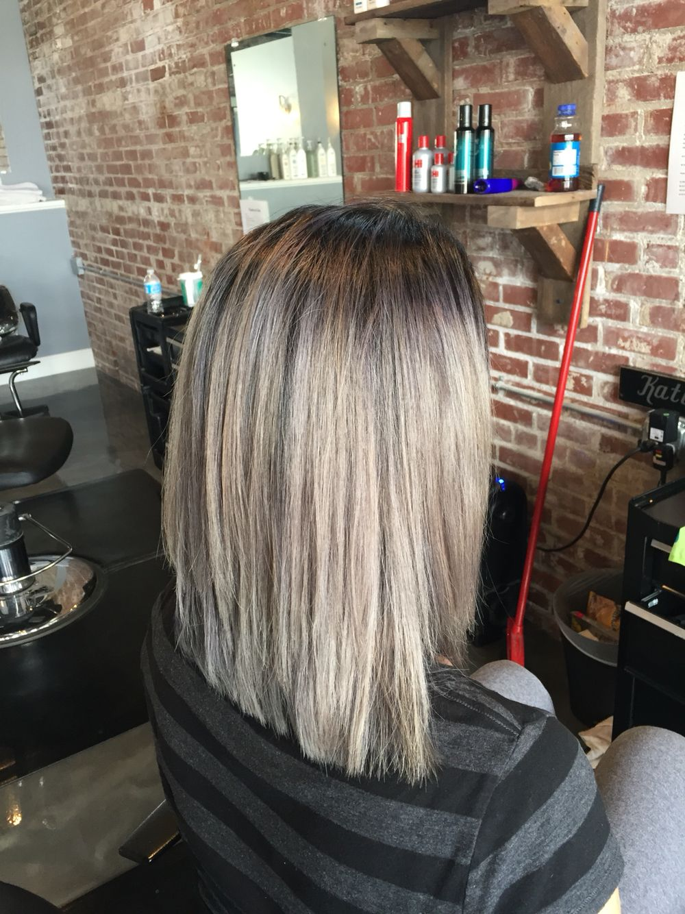 Light silver hair with dark rooted look layered bob kreations by