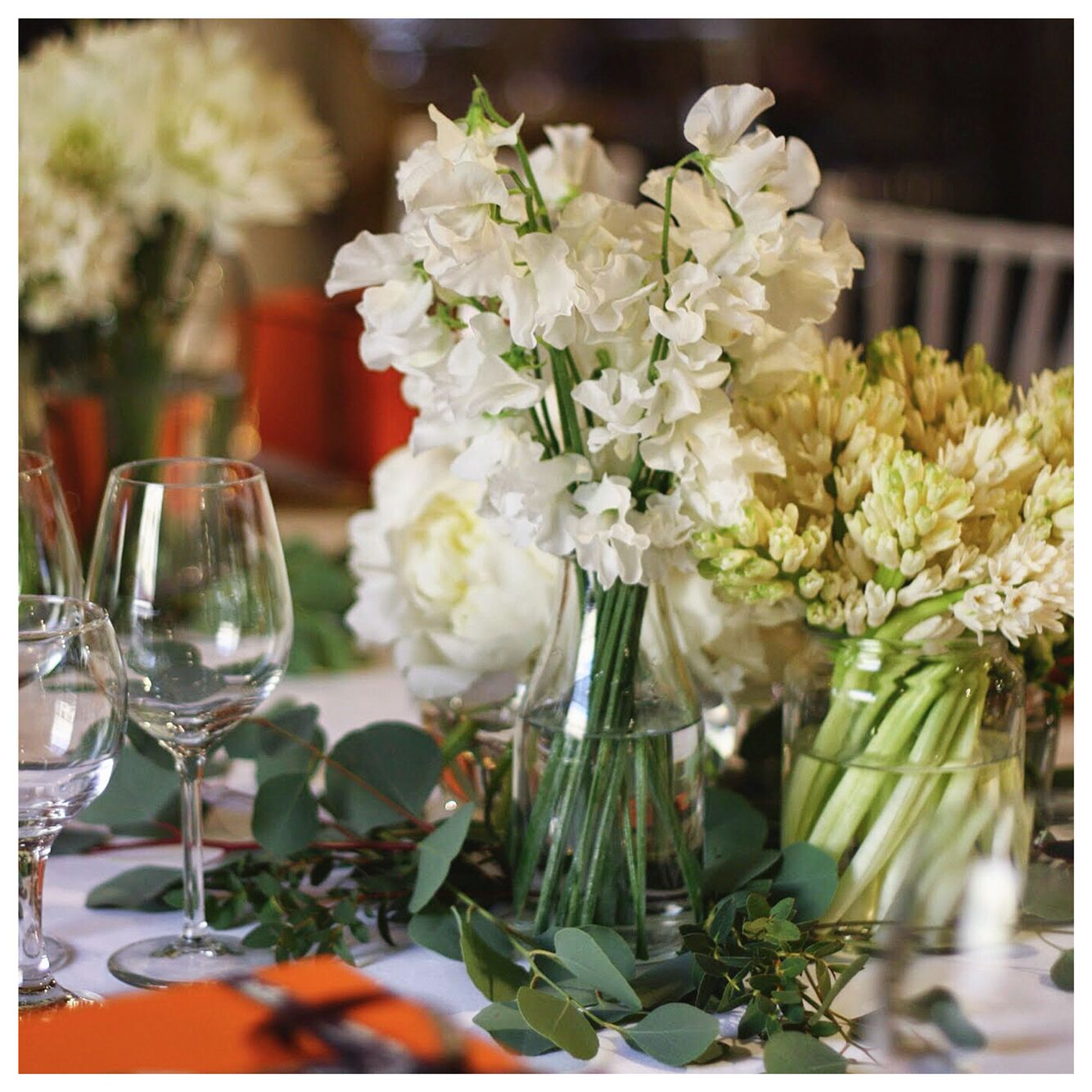 Clusters of white arrangements for an all white tablescape