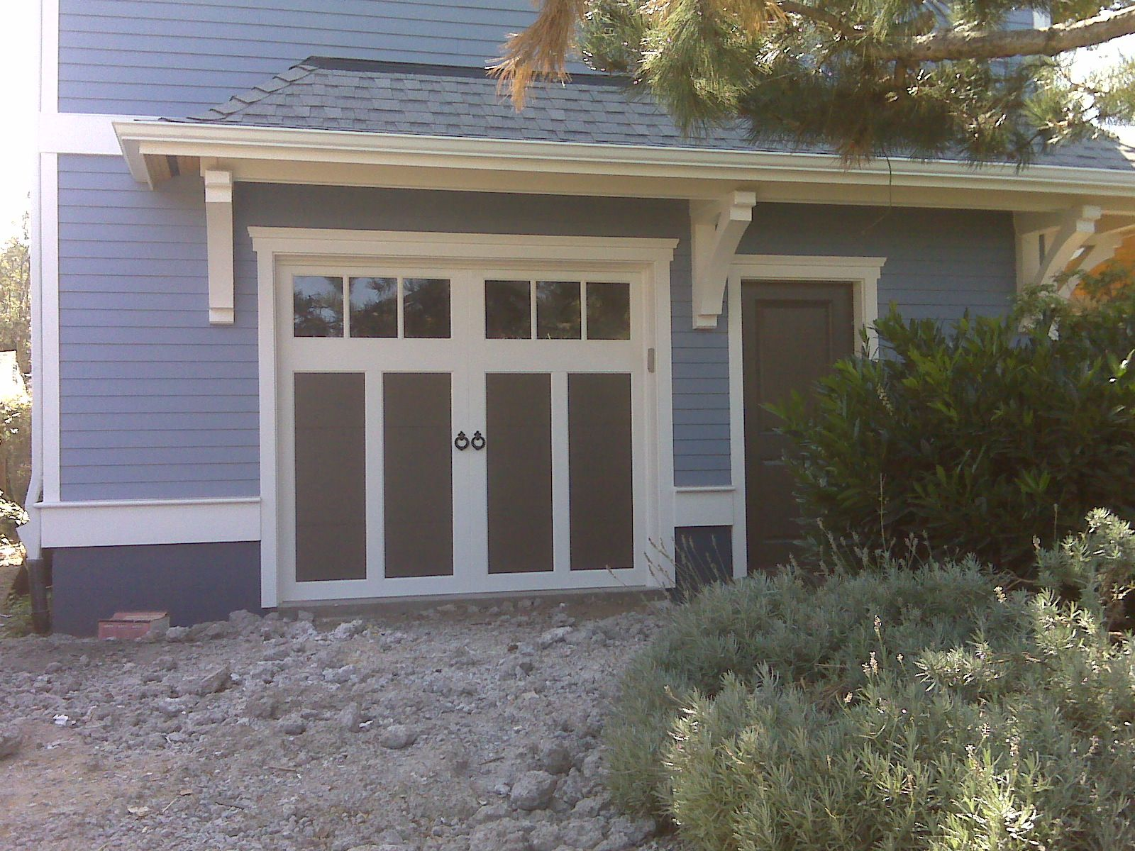 Clopay Coachman Collection Carriage House Garage Door Design  With Rec Windows Custom Painted To