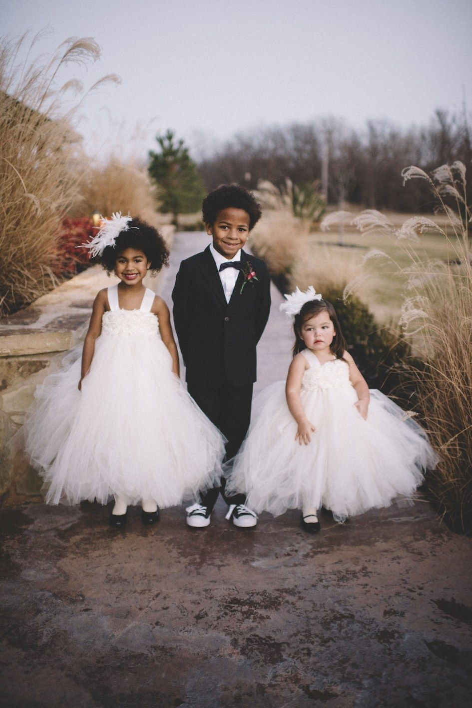 The most darling flower girls and ring bearer for a classy winter