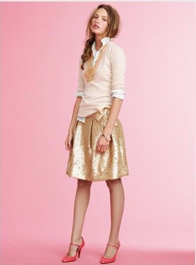 gold skirt, white collared shirt, pink sweater