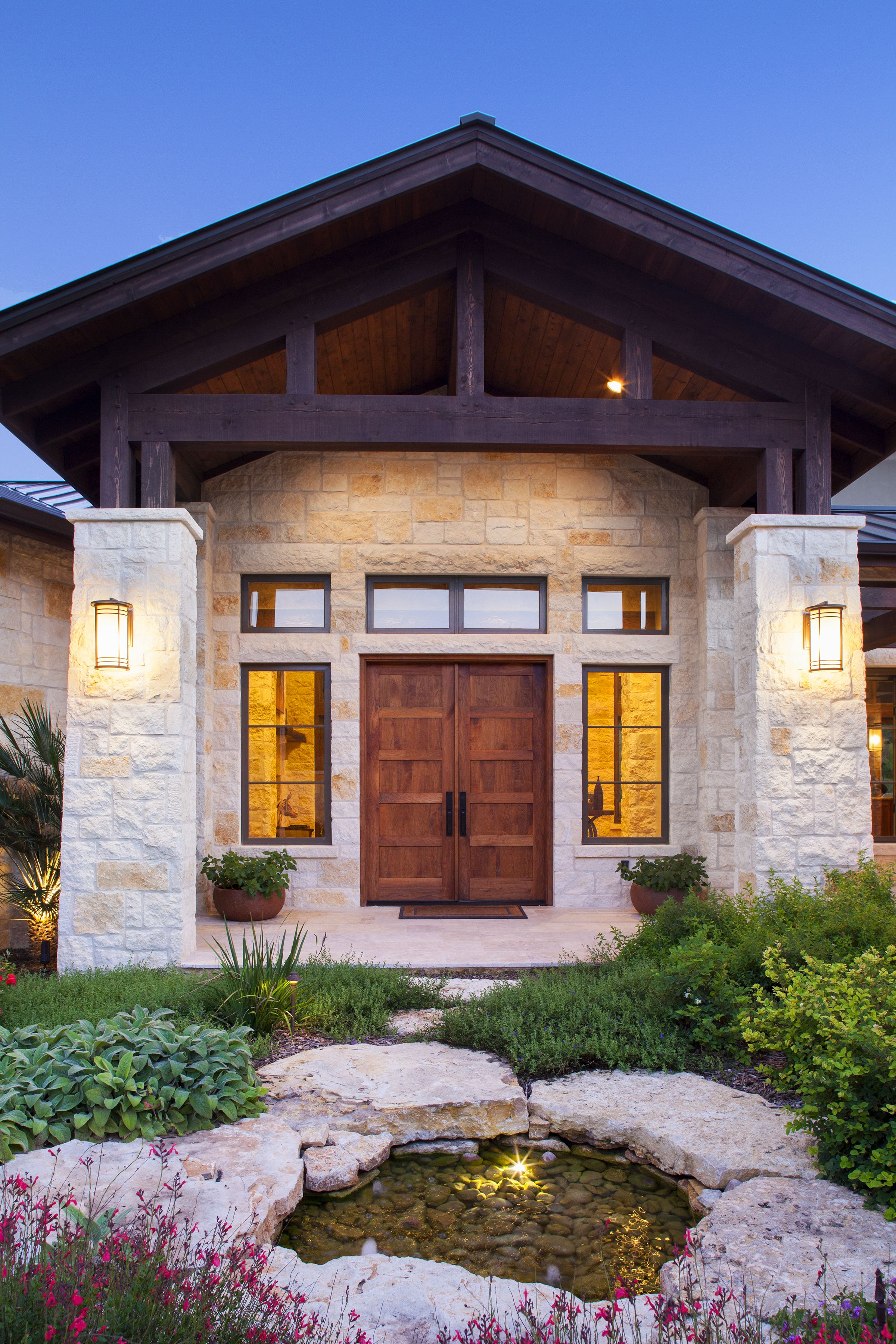 Stone Columns Wood Beam Details And Large Windows Add Interest To The Front Elevation Of This Texas T Ranch Style House Plans Hill Country Homes Rustic Entry