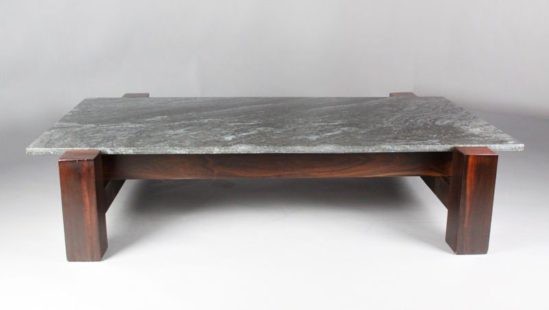 A rectangular solid rosewood coffee table from brazil with