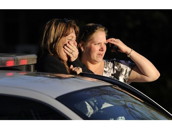 Women, one of whom is believed to be a family member of the victims, cry when they see a stretcher come out of a home on the 600 block of B Street without anyone on it following a shooting in Yuba City on Tuesday, Feb. 14, 2012. Three people including the gunman are dead and one victim was transported to the hospital.  David Bitton/Appeal-Democrat