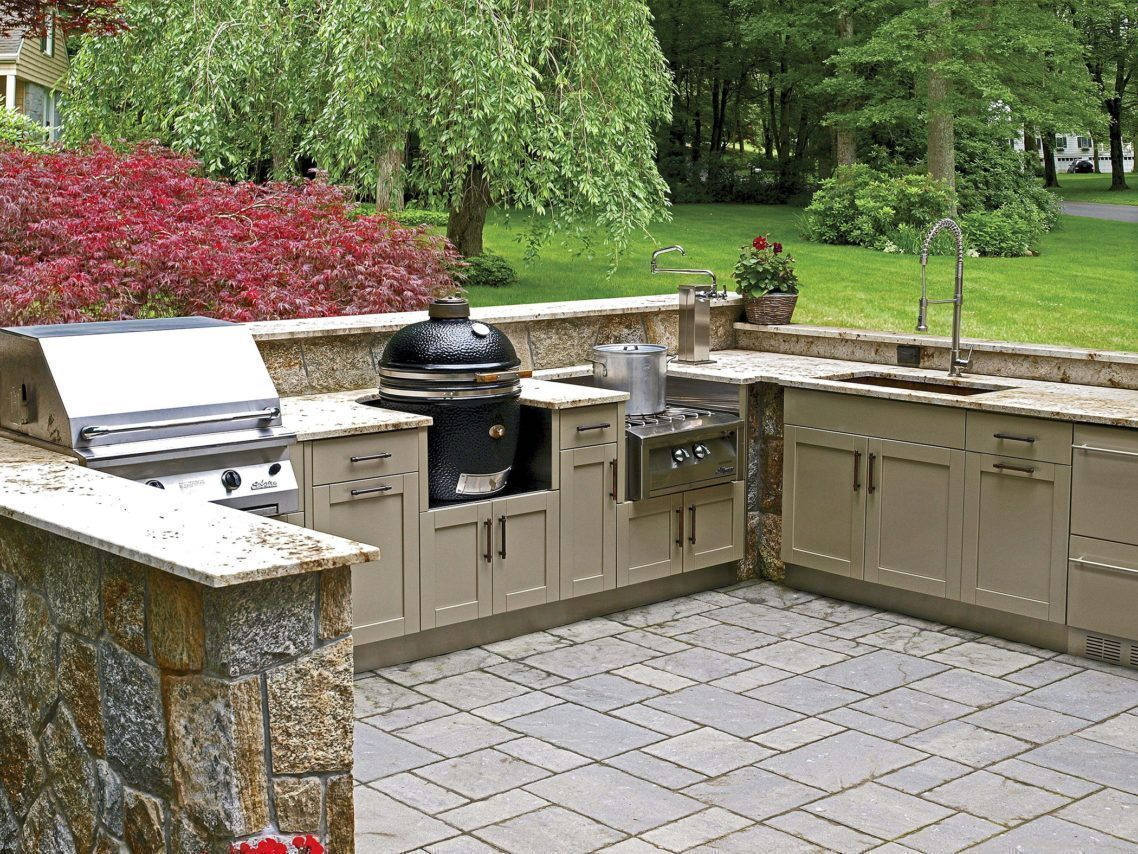 Beautiful beige painted finish wood outdoor kitchen cabinets in
