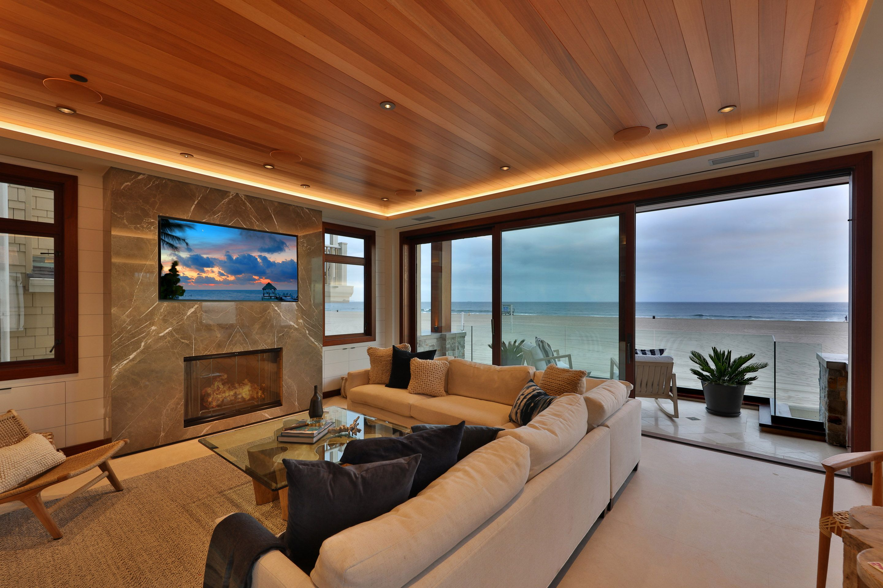 Modern Luxury Living Room With Wood Ceiling And Ocean View Living Room Wood Luxury Living Room Luxury Living