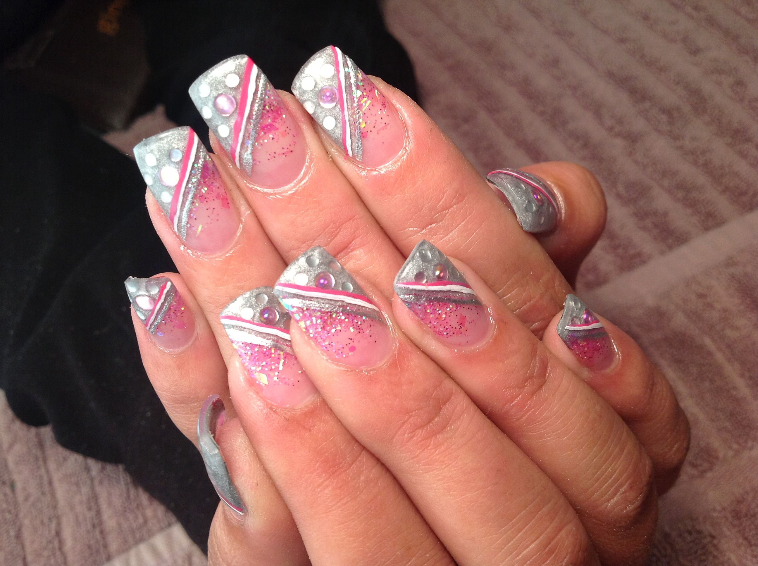 Silver and pink with painted detail nail art