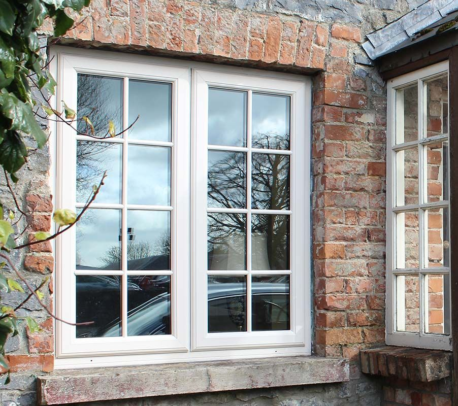 French pvc window in cream with georgian bars for that for Wood effect upvc french doors