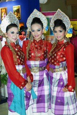 Malaysian Girls Dancing In Traditional Dress At Wedding Festival