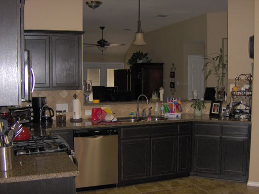 Detail of Kitchen Cabinets painted satin black then ...
