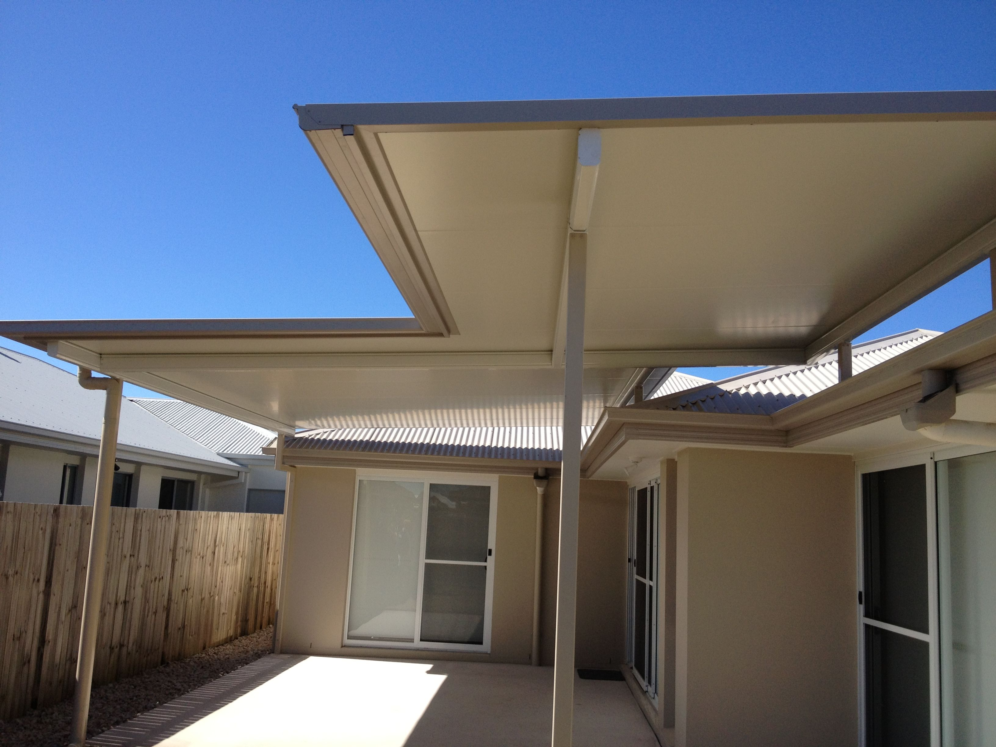 Stratco Cooldek Fly Over Patio That Was Built To Provide Cover For An Outdoor Area And To Prevent Glare Into The H Pergola Plans Design Carport Designs Pergola