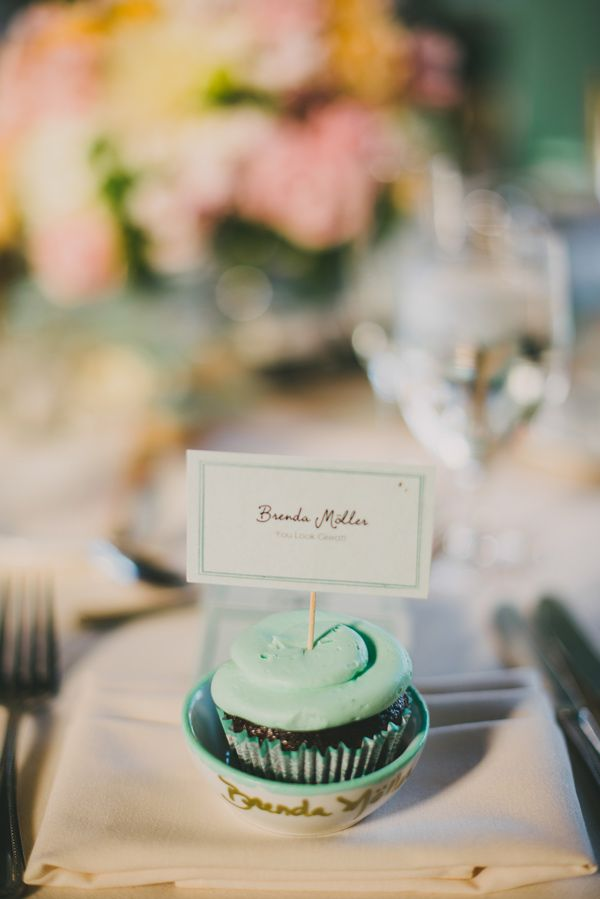 cupcake at each place setting (doubles as a place card!), photo by SetFour Photographers http://ruffledblog.com/multicultural-san-diego-wedding #weddingideas #reception