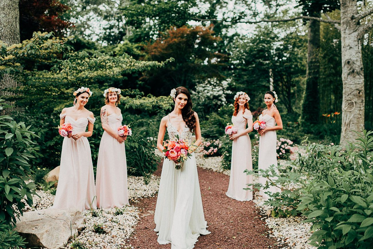 Bridesmaids in blush pink gowns by JLM Occasions