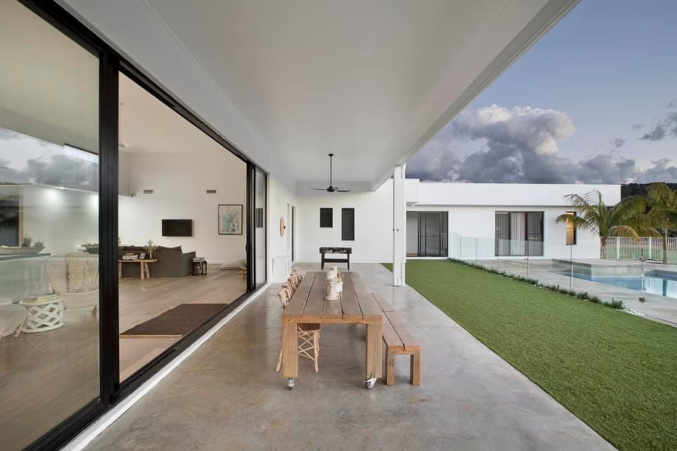 Onlooking this open backyard with modern swimming pool, this home takes advantage of its open plan living room. Built by the G.J. Gardner team at Ballina.