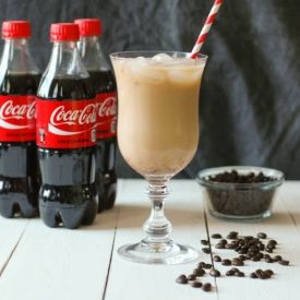 Coke with Iced Coffee - It's on the menu in a local coffee shop in Denver.  Refreshingly different.