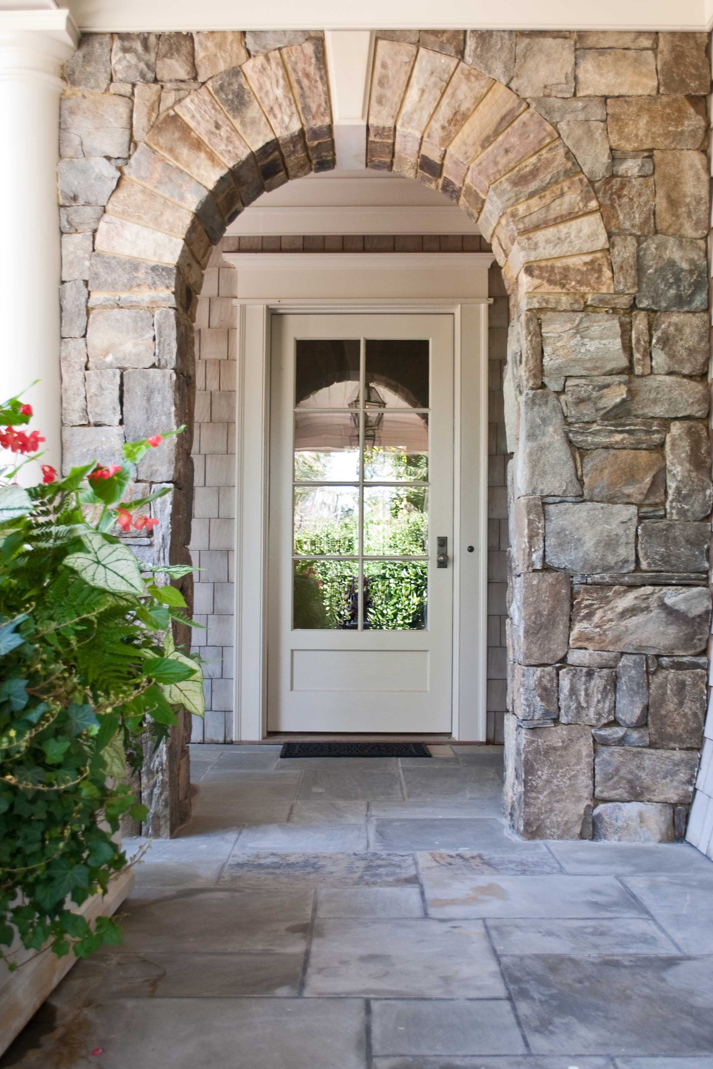 Heartwood Fine Windows And Doors Stone Exterior Houses Stone Houses Painted Front Doors