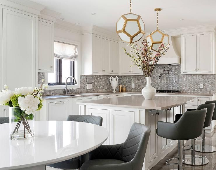 Elegant Eat In Kitchen Features A Round White Dining Table