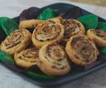 Serve savory Pesto Pinwheels as hors d'oeuvres for your next party. Your guests will be impressed!