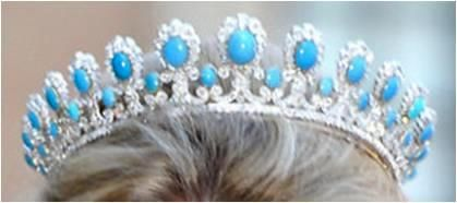 Saxe-Coburg Gotha Turquoise & Diamond Tiara    A button style tiara with a larger set of turquoise stones, each surrounded by diamonds, set atop a framework of diamond scrolls. The larger buttons are separated by smaller turquoise pieces. The tiara is part of a set that also includes a necklace, earrings, and a brooch. We see the tiara on another Saxe-Coburg and Gotha lady: Kelly, the American wife of Hubertus, Hereditary Prince of Saxe-Coburg and Gotha.