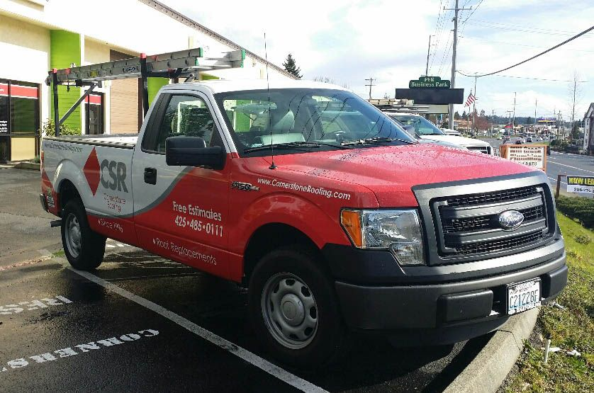 Red and white Truck wrap with company branding and contact