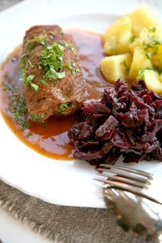 Photo of Juicy beef roulades with strong dark sauce and apple ro …
