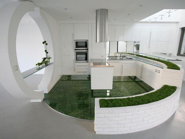 Une cuisine design blanche arrondie tr s orient e nature o m me le sol est fait d 39 herbe - Tres belle cuisine equipee ...