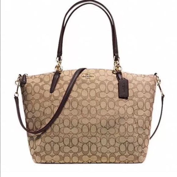 Authentic Coach NWOT F36722 Brown Khaki Purse This bag is immaculate and like new!  It was used 1-2x.  Retails in stores for $329 plus tax.  This is from a smoke and pet free home.  We are moving OR I wouldn't be selling this one.  Please check out my closet, as I m truly cleaning out the closet.  Thanks! Coach Bags Shoulder Bags
