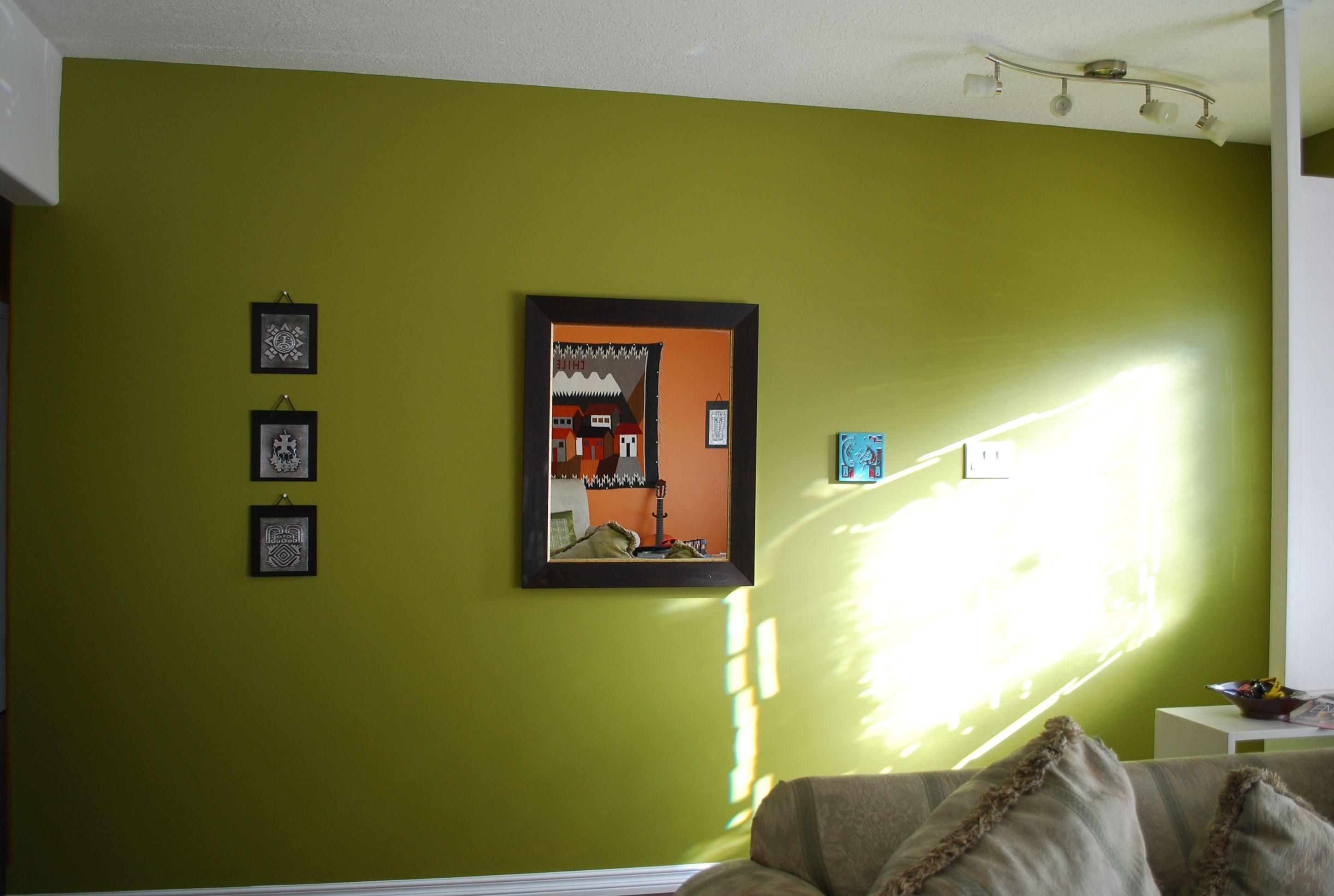 This is almost exactly the color we have, and the light fixture ...