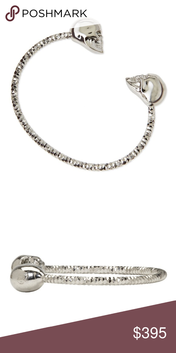 f3ebff6fe24 Alexander McQueen Cuff Authentic Alexander McQueen twin Cuff bracelet.  Silver with clear colored crystal eyes. This bracelet has normal wear.