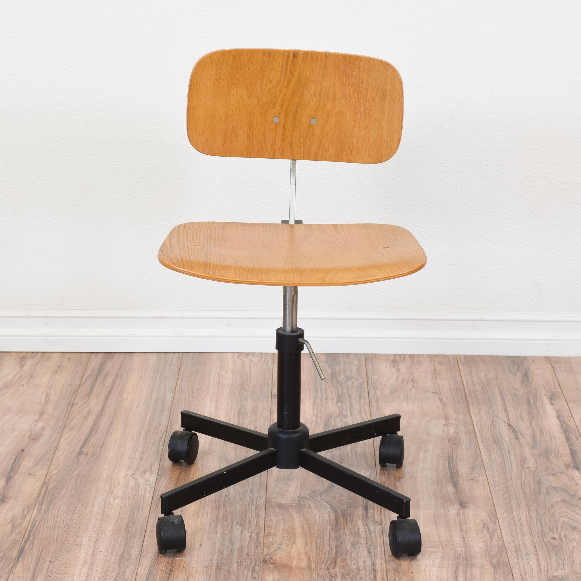 This danish modern chair is featured in a solid thin wood with a