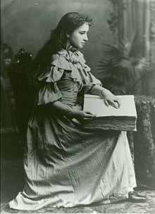 Helen Keller reading braille. She was born in Tuscumbia, AL.