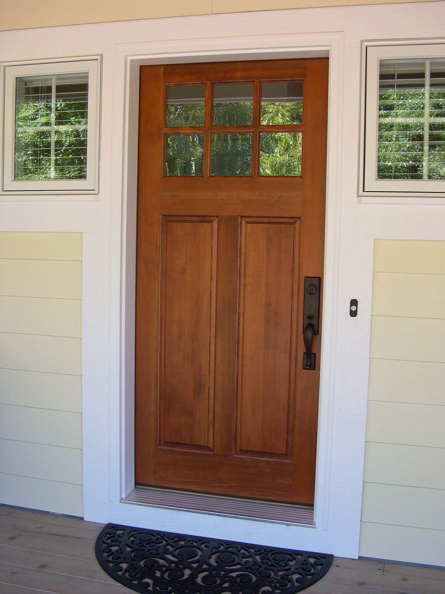 Front entry cottage style stained front door troxel for Custom front doors
