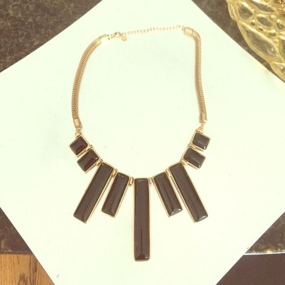 Black and gold statement necklace Black and gold statement necklace. Perfect condition. Adjustable chain ALDO Jewelry Necklaces