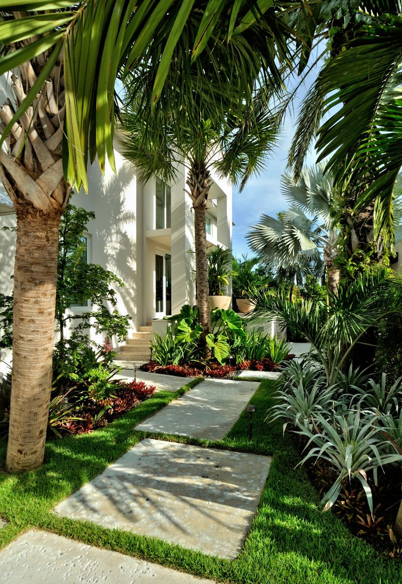 Tropical Entrance To A Large House With Planters At The