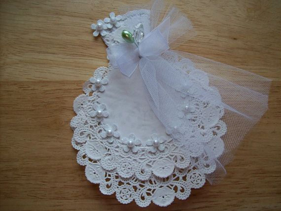 This listing is for a white wedding gown embellishment for scrapbook layouts. This handmade frilly little gown made from paper doilies and