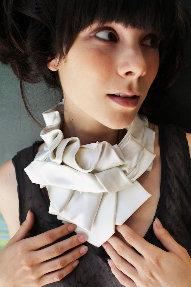 White Violet Ruffle Collar... this would be amazing with the perfect black top or dress.