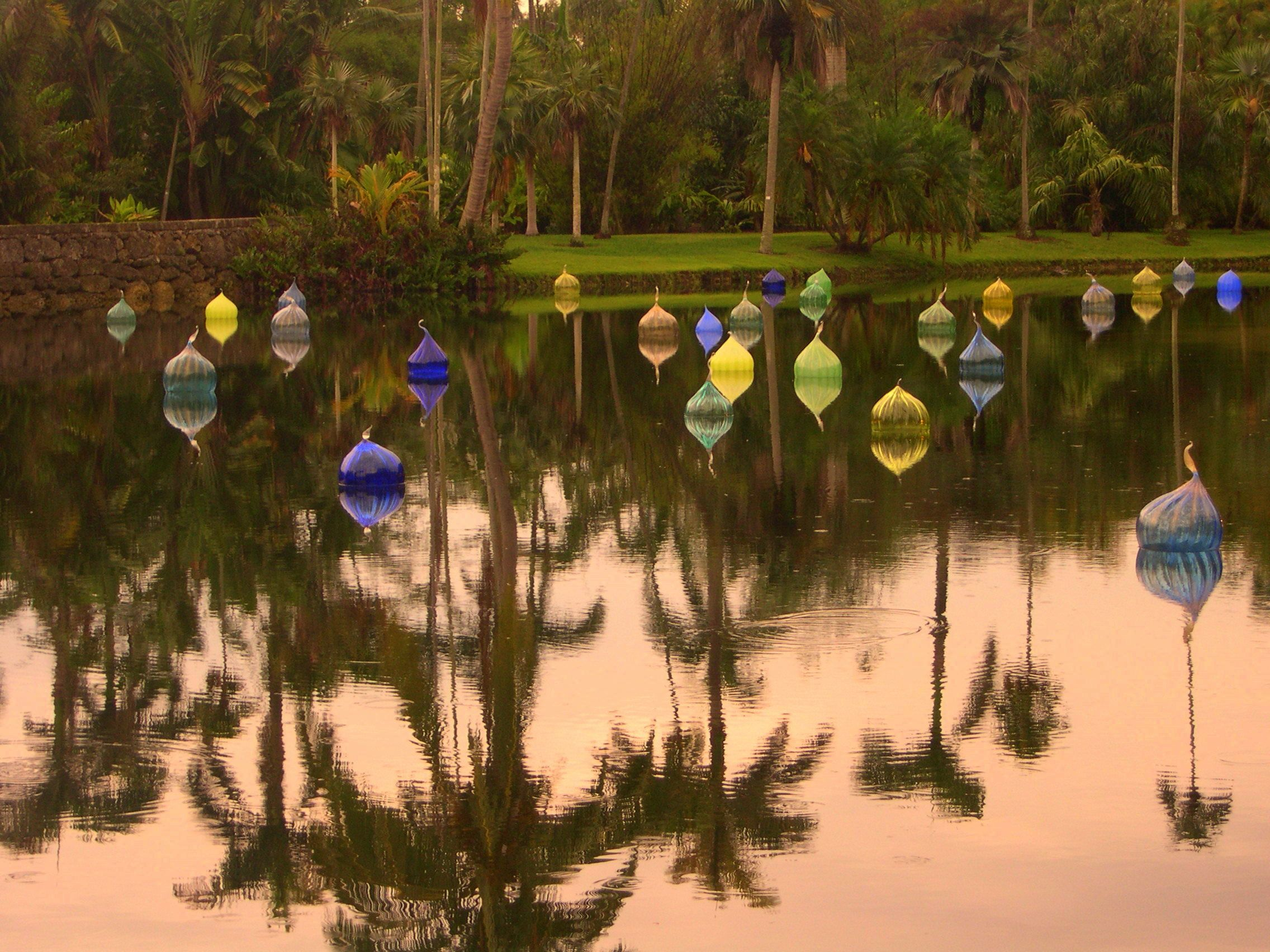 Chihuly globes floating in the Fairchild Botanical Garden | The ...