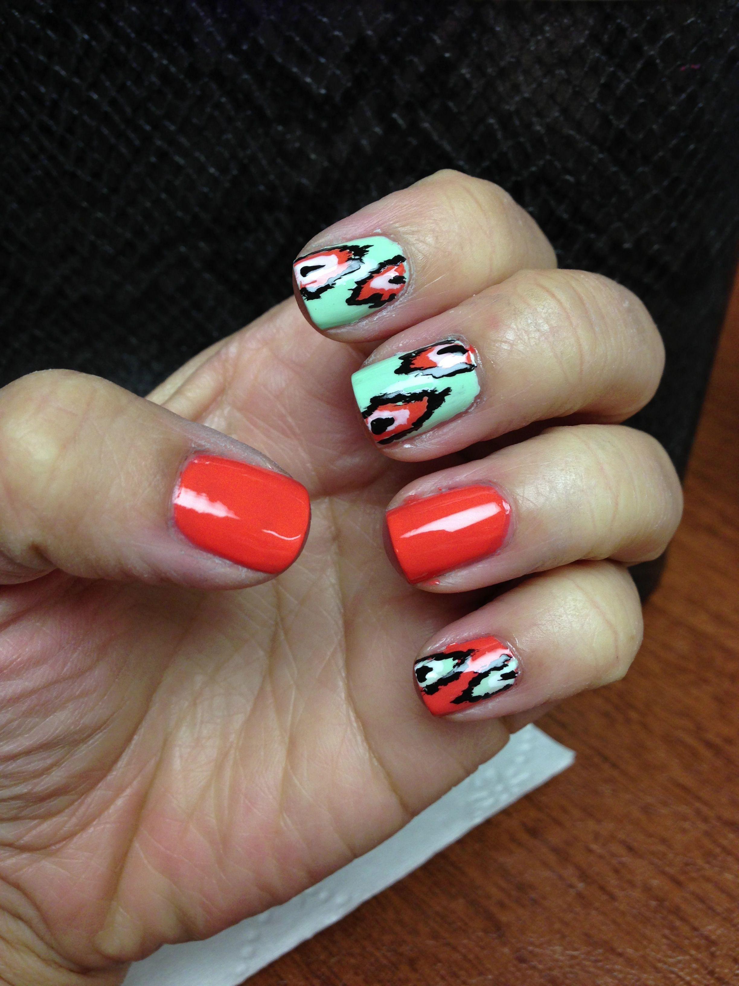 Ikat nailsbut make the pointer finger solid aqua lovin it