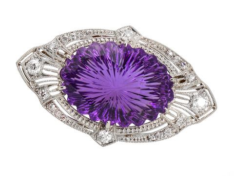 A Cut Above - Black Starr & Frost Amethyst Brooch. A medium deep-hued amethyst of 28.5 carats (24 by 18 mm) is scalloped along the edges in an overall oval form... Of platinum filigree with minute mille grain (beaded edges) it is set with 19 diamonds, with a total weight of just shy of 1 carat (.90 carats of antique diamonds.)  c 1925
