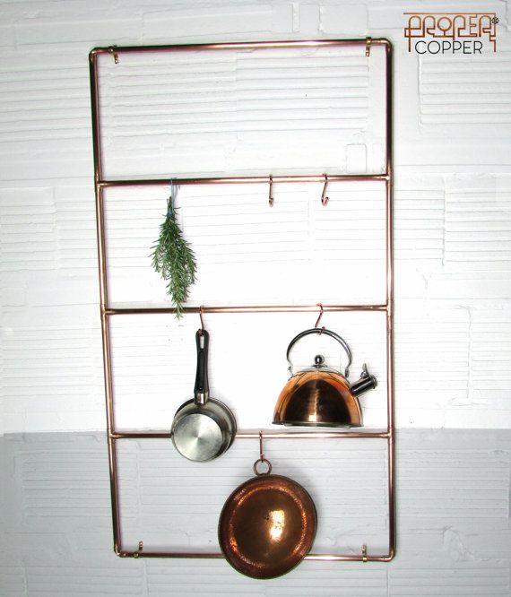 Proper Copper Pan Rack  Immensely practical hand crafted POT, PAN RACK made from pure 15mm copper pipe, will grace any kitchen and is exclusively designed by Proper copper design. Perfect for enhancing a modern industrial look. It comes complete with 5 copper S shaped hooks. Finish: Proper Copper products are all polished and treated with anti tarnish Lacquer to preserve the copper for many years... Or Our products can also be sold natural without the lacquer if tarnished copper is the look…