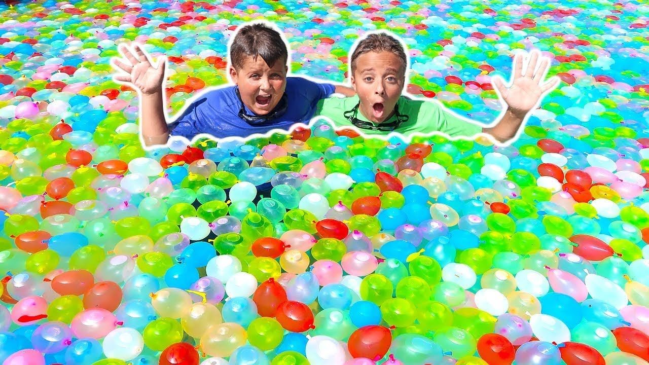 Thousands of Water Balloons In The Giant Swimming Pool Fun