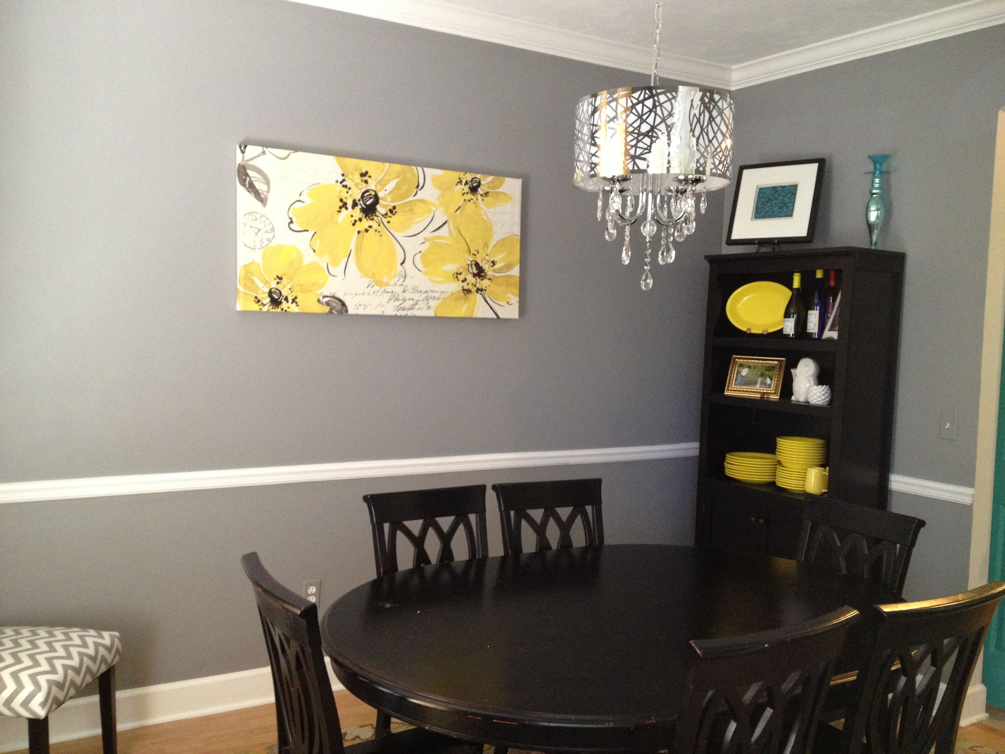 Grey and yellow dining room with a fabulous chandelier