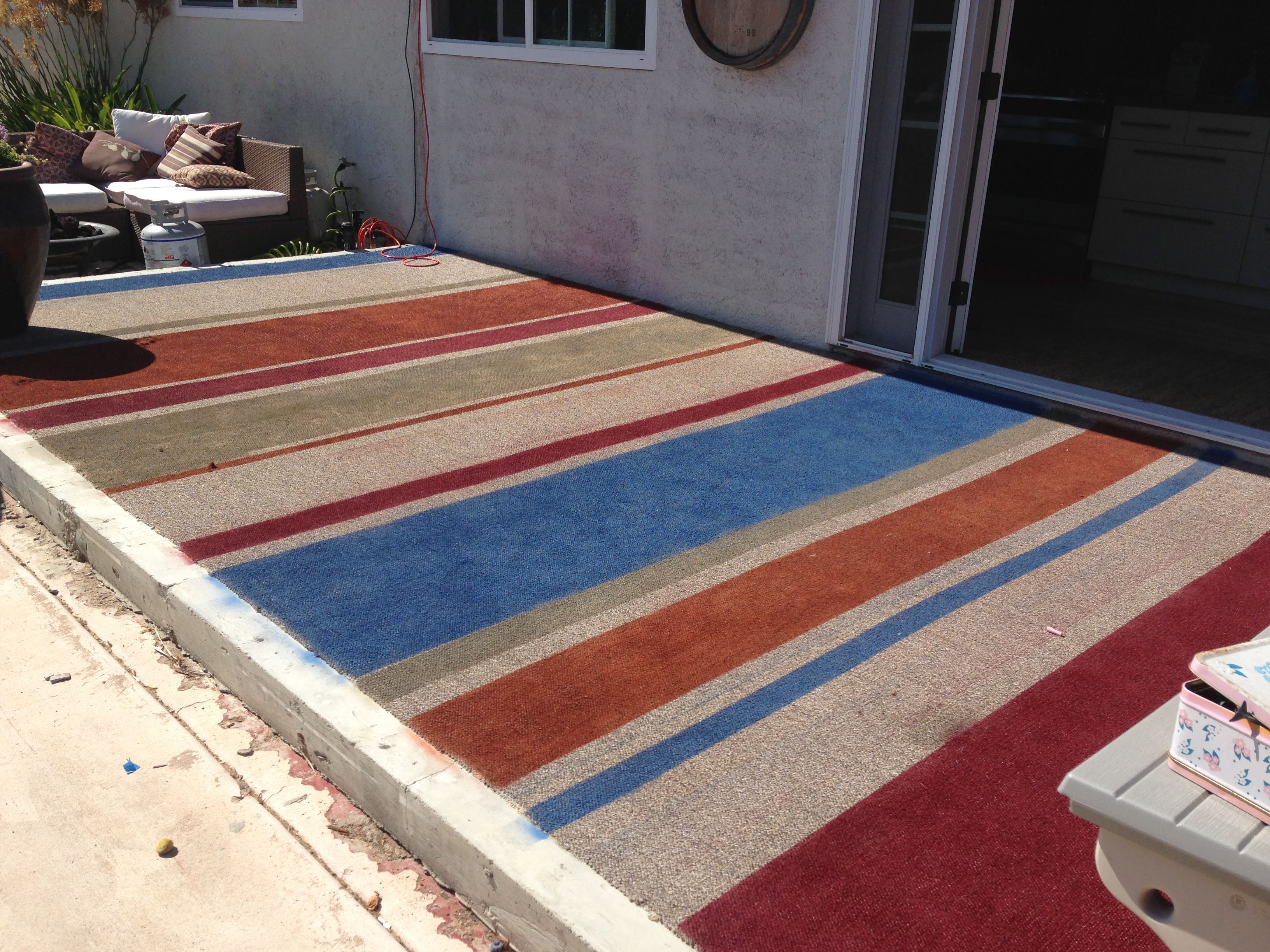 spray painted outdoor rug used 2x rustoleum paint taped off and