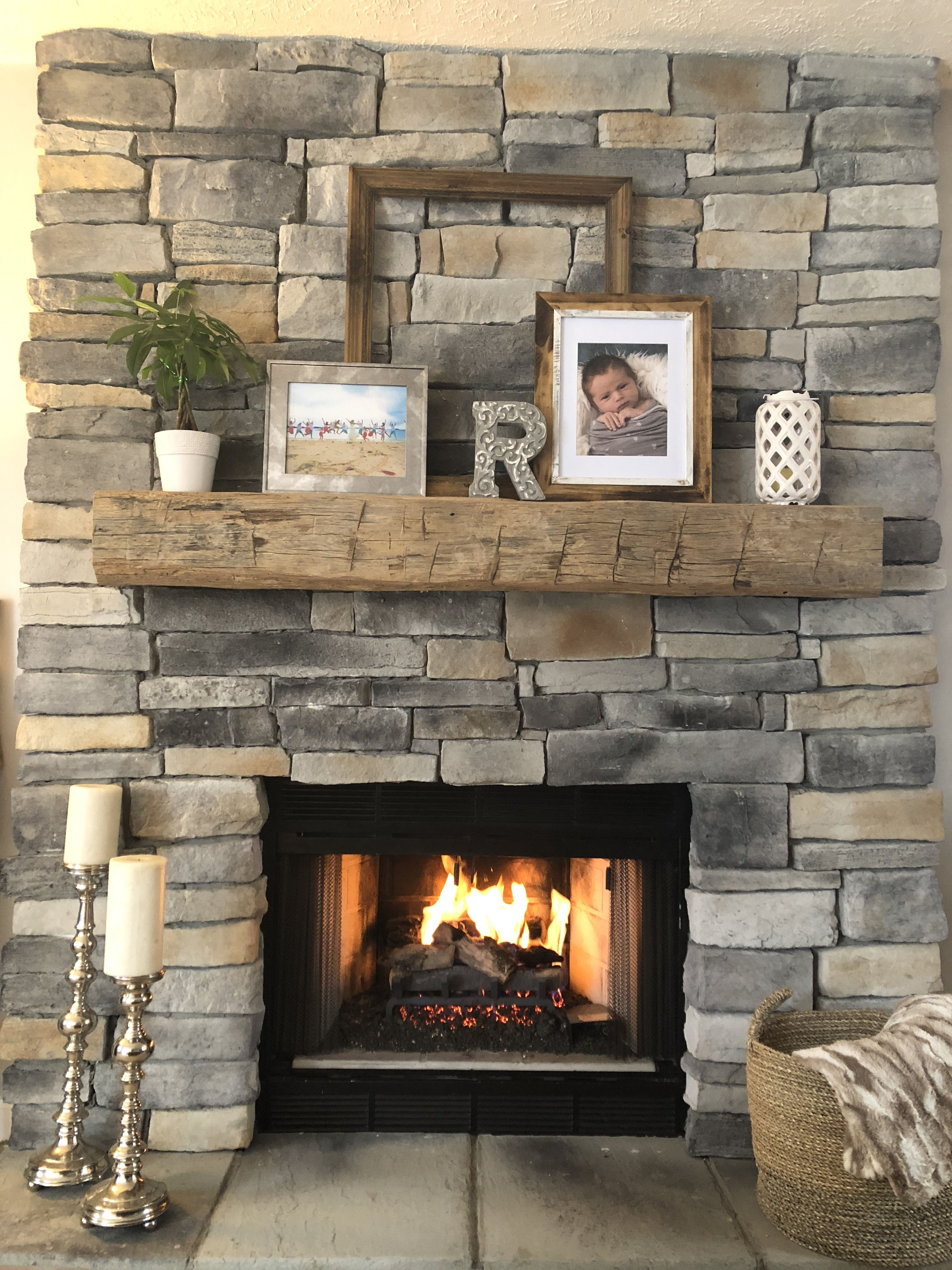 Stone Floor To Ceiling Fireplace With Rustic Mantle Living Room