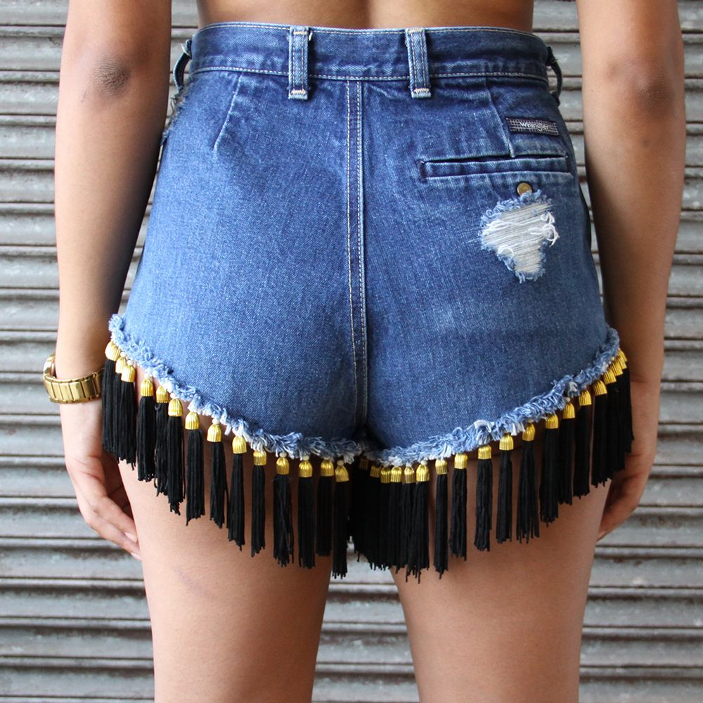 "What's better than a perfectly fitting pair of denim shorts? Perfectly fitting denim shorts that'll dance as you walk! These 5-pocket, heavily distressed shorts are high waited with raw-edged hems. Hems are detailed with black and gold fringe making these shorts fun and flirty. Shown here with our ""Kendall"" bandeau and ""Jane"" choker."