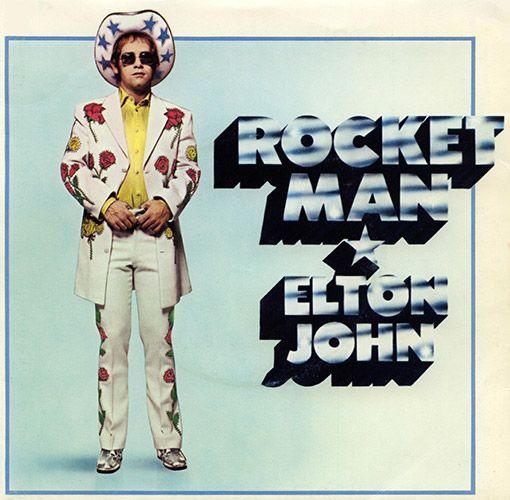 "Elton John wears a custom Nudie suit on the cover of 1972 single ""Rocket Man"""
