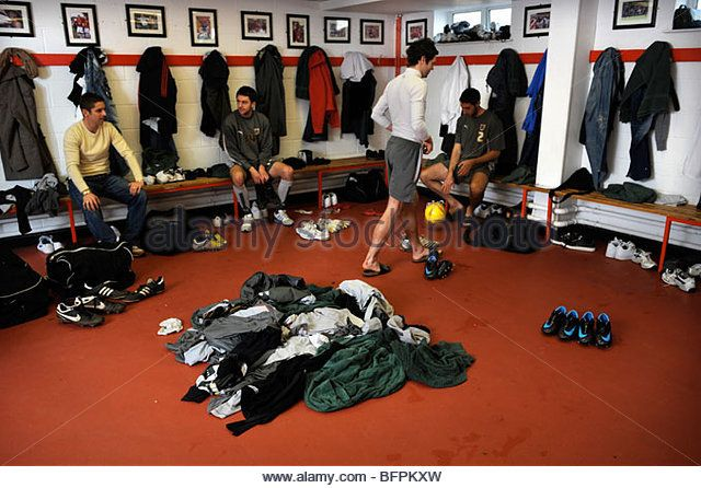 A footballers changing room with dirty kit piled on the floor UK - Stock Image
