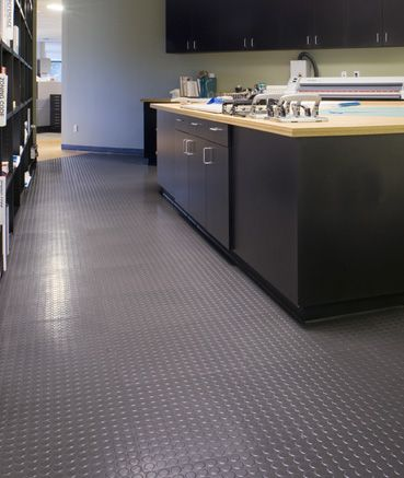 Roppe Rubber Tile With Raised Circular Design Want For Basement